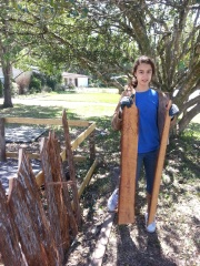 Tabitha making fence